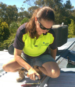 Lady tradie leading the way, one watt at a time.